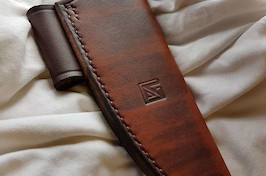 An example leather sheath with a firesteel loop for a bushcraft knife