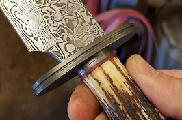 A presentation Bowie in Damasteel, stainless fittings and  sambar stag...a very special knife!