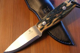 O1 carbon bushcrafter, dressed up in the finest blue mammoth ivory